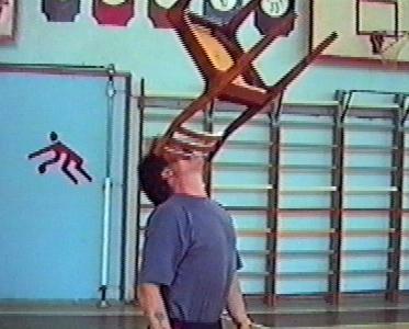 Man picks chair up with teeth