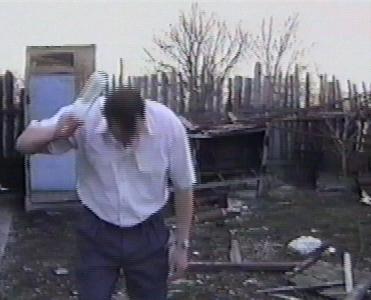 Man breaks glass bottles on head