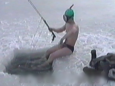 Man strips off by ice hole, dives in