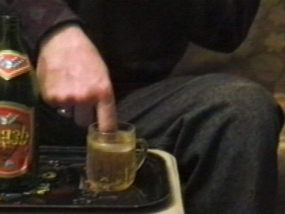 Man drinks beer using a finger
