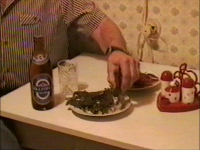 Man eats live crabs with beer