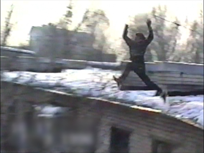 Woman jumps from roof into tree