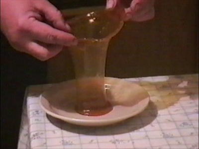 Man making vase from hot toffee