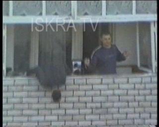 man falls off balcony, rises and walks
