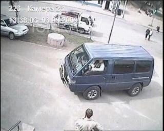 van driving into a shop, cctv
