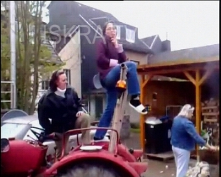dancing girl falls off a tractor