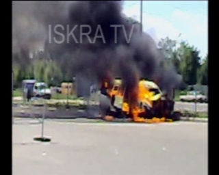 vehicle burning in street explodes