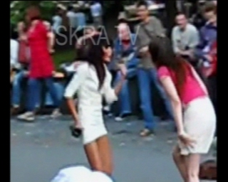 two girls strip while dancing in public