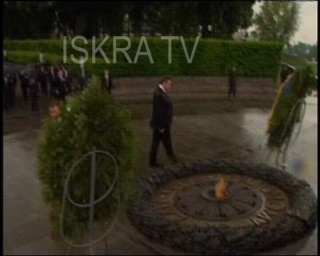 wreath falls on official during ceremony