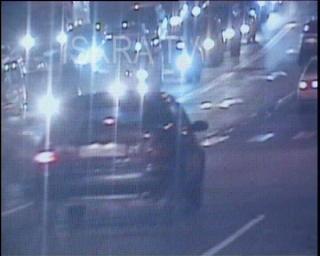 man jaywalking hit by a car at night