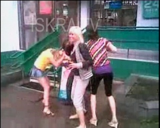 women fighting outside a pharmacy