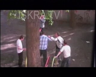 two men fighting in yard