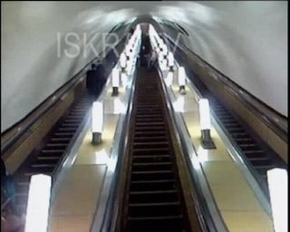 man falls down escalator in Moscow metro