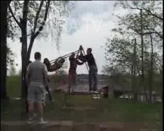 swing goes full circle and man falls off