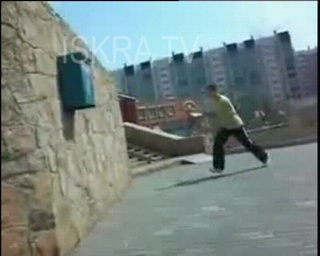 young man trying parkour hits a post box