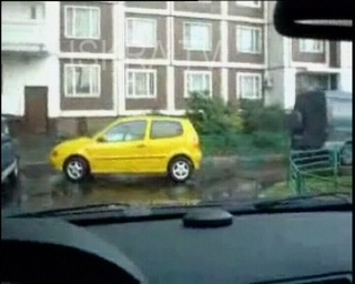 yellow car being parked