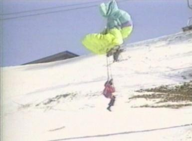 paratrooper lands on the cables of a funicular