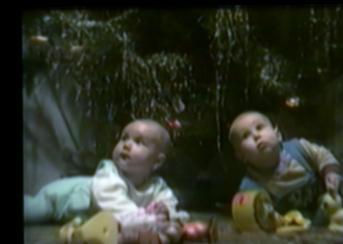baby pulls down Christmas tree