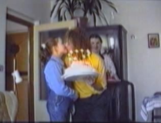 man's hair catches fire from birthday cake