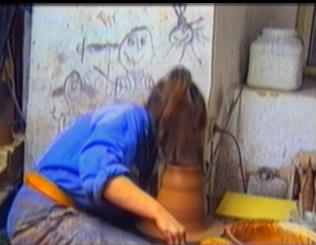 woman's hair gets entangled into a pottery  wheel