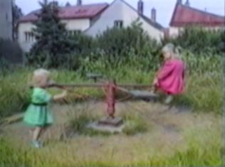 girl falls off a roundabout