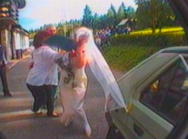 Bride crashes into camera