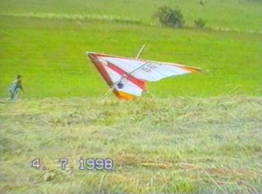 Wind blows glider, man runs after it