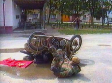 Motorbike with sidecar turns over