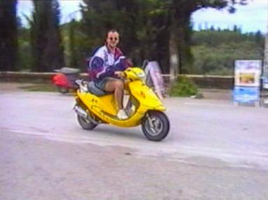 Man on scooter crashes into goods stand
