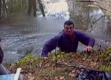 Fisherman falls into water