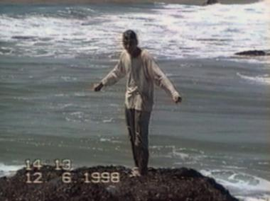 Man drenched by sea wave
