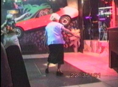 Woman dancing in a disco falls down