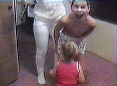 Toddler bites at boy's knackers