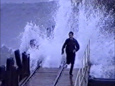 Man chased by waves