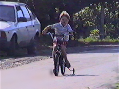 Boy falls over bicycle