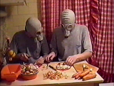 People with gas masks prepare food