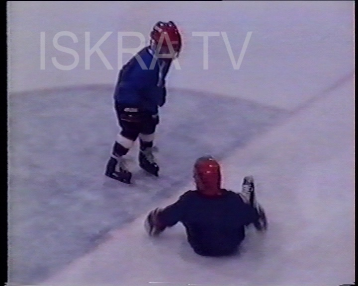 boys fighting it rough on ice