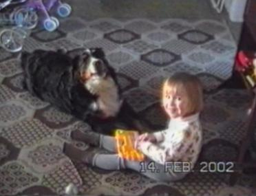 Girl playing keyboards, dog sings