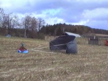 Sledge pulled by parachute in high wind