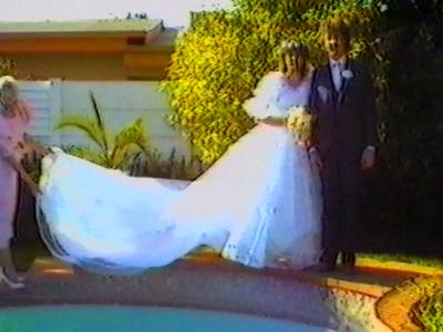 Newlyweds fall in to swimming pool