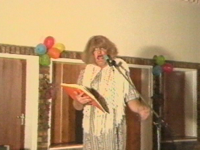 Man in drag sings out of tune