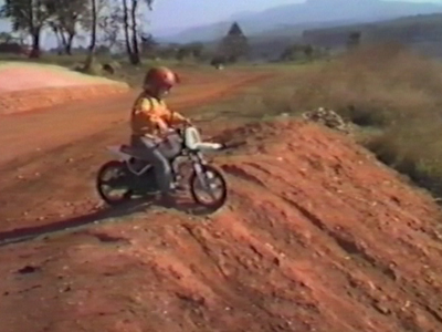 Boy crashes a motorbike in to a log