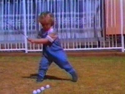 Small boy playing golf
