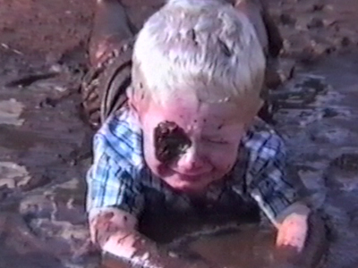 Kid plays about in the mud