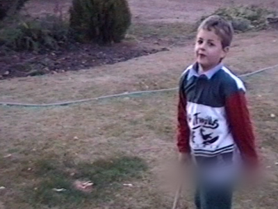 Boy with whip, hits himself in the ear