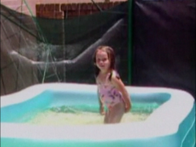 Girl falls off paddling pool