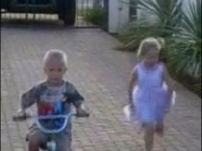 Small boy falls off bike
