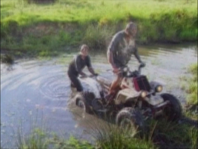 Man covers woman in mud from quad bike