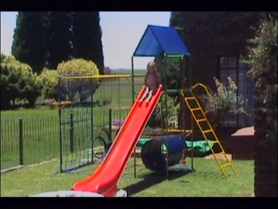 Girl misses pool at the bottom of slide
