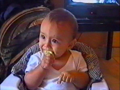 Baby eats a lemon